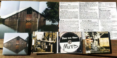 Mutts - Pray for Rain - Debut LP coming December 13, 2011 - Cover image is a barn submerged halfway up its walls by a flood, taken by Lisa Marie Geisler of the man-made Missouri River floods in the summer of 2011